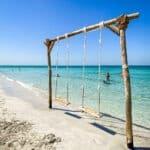 kite beach umm al quwain swings in the sea